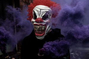 Person wearing scary clown mask